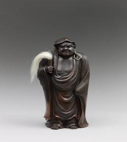 A Bizen pottery sculpture of Daruma