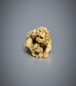 Ivory netsuke of a shishi and cub
