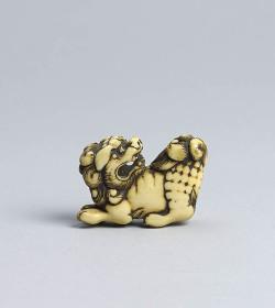 Ivory netsuke of a shishi