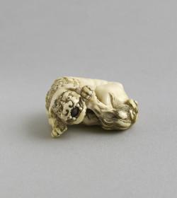 Ivory netsuke of a recumbent shishi