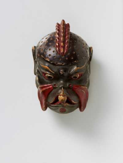 Lacquered wood mask netsuke of Karura