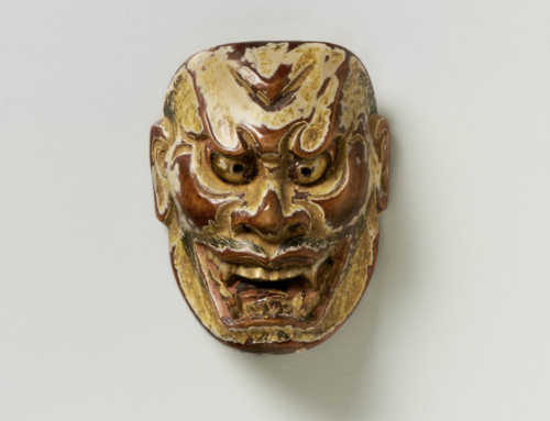 Kōmon | Wood Mask Netsuke of Shikami