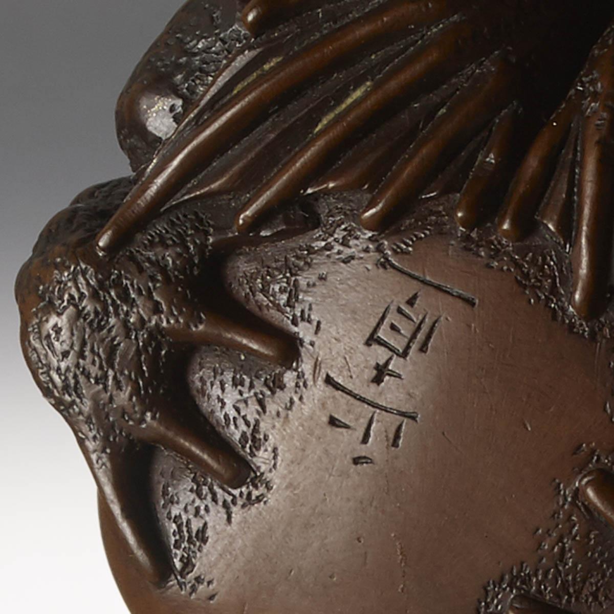 signature on Wood Netsuke of Frogs by Masanao of Yamada