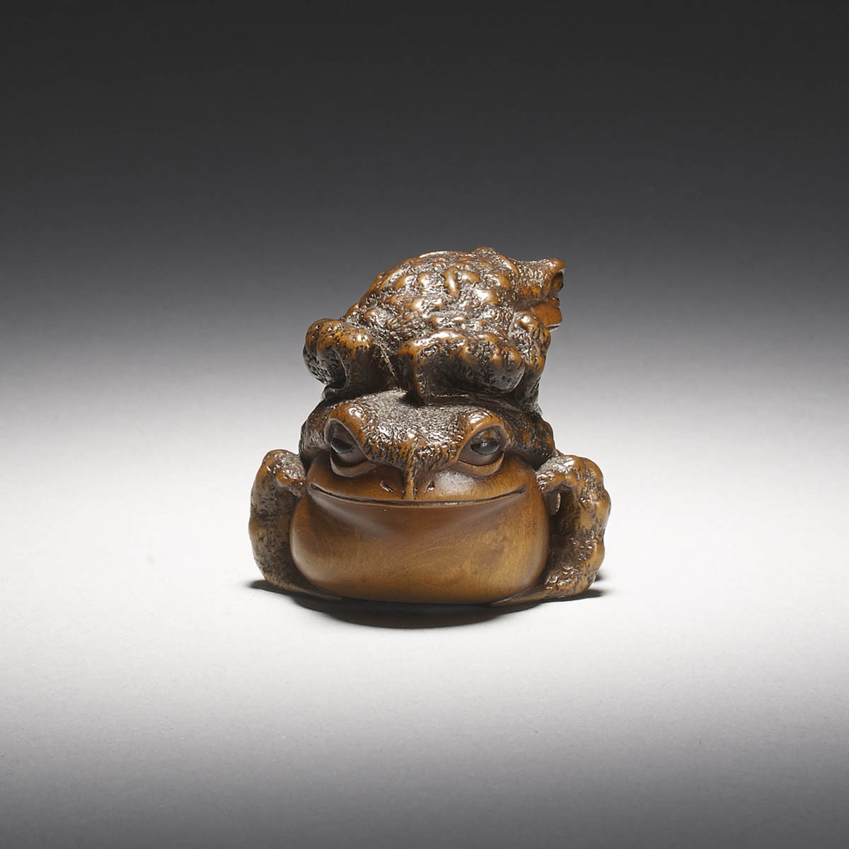 Close Up view of Wood Netsuke of Frogs