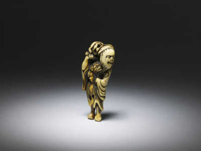 Ivory netsuke of a sennin with shishi