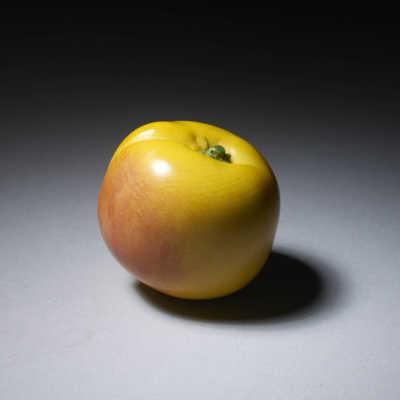Ivory okimono of a small peach