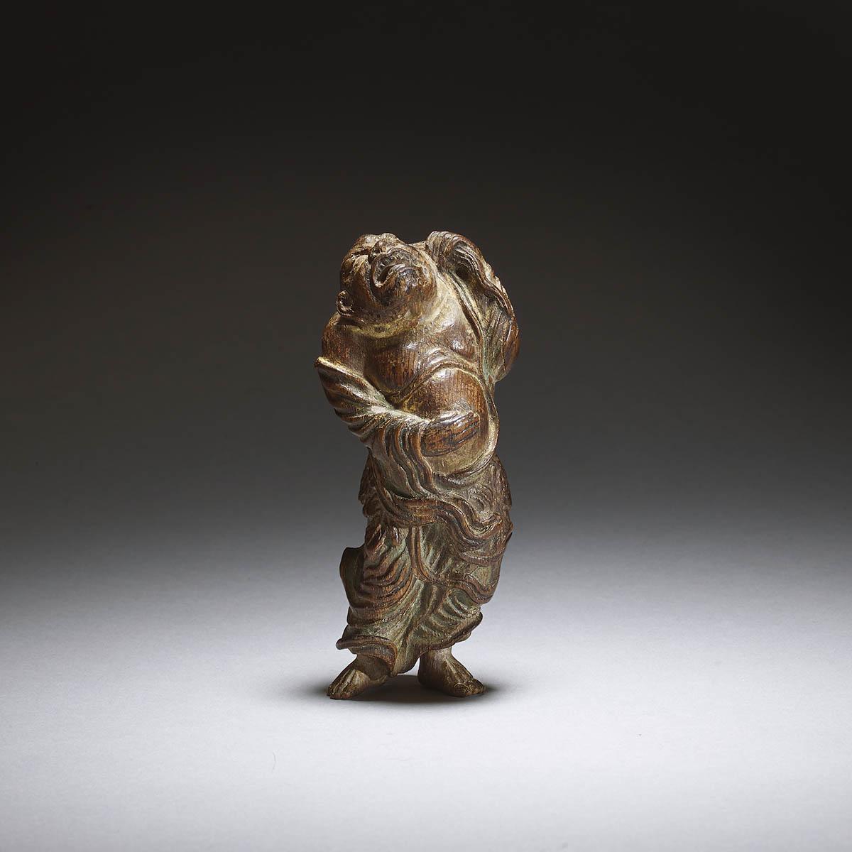 Cypress wood netsuke of Tekkai Sennin by Yoshimura Shuzan