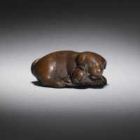 Boxwood netsuke of a dog by Shugetsu I
