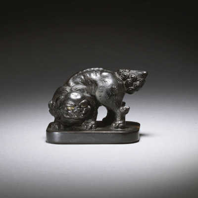 Ebony seal netsuke of a shishi