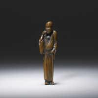 Boxwood netsuke of a thin blind man by Hokyudo Itsumin (Active 1830-70)