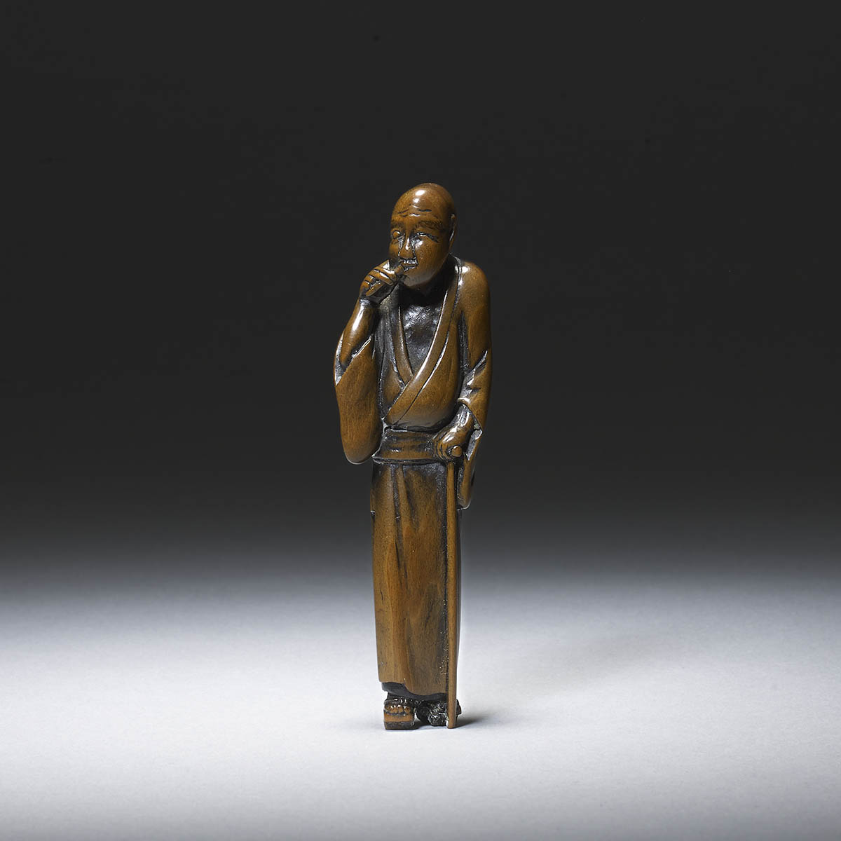 Boxwood netsuke of a thin blind man by Hokyudo Itsumin (Active 1830-70)