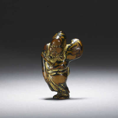 Worn lacquered boxwood netsuke of Okame