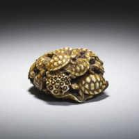 Dark stained ivory netsuke of turtles
