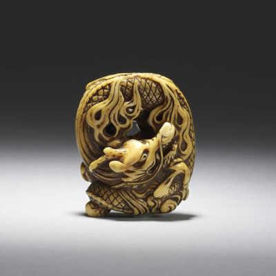 Mitsuharu coiled dragon ivory netsuke