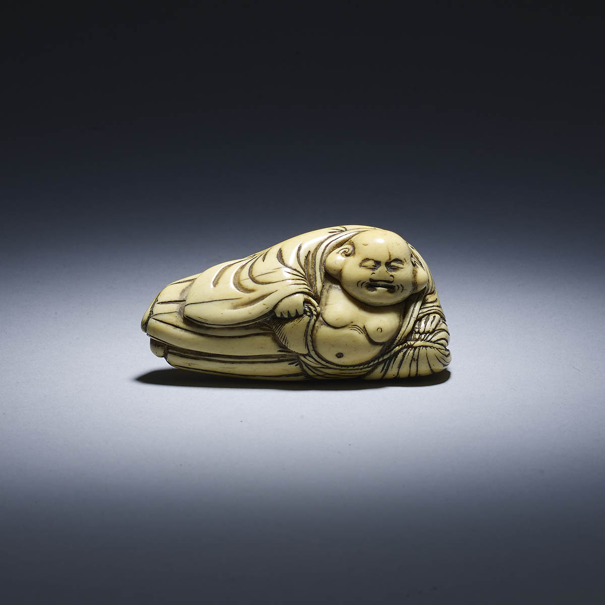 Netsuke of Hotei recumbent