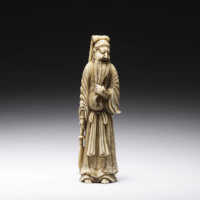 Tall ivory netsuke of Kan'u