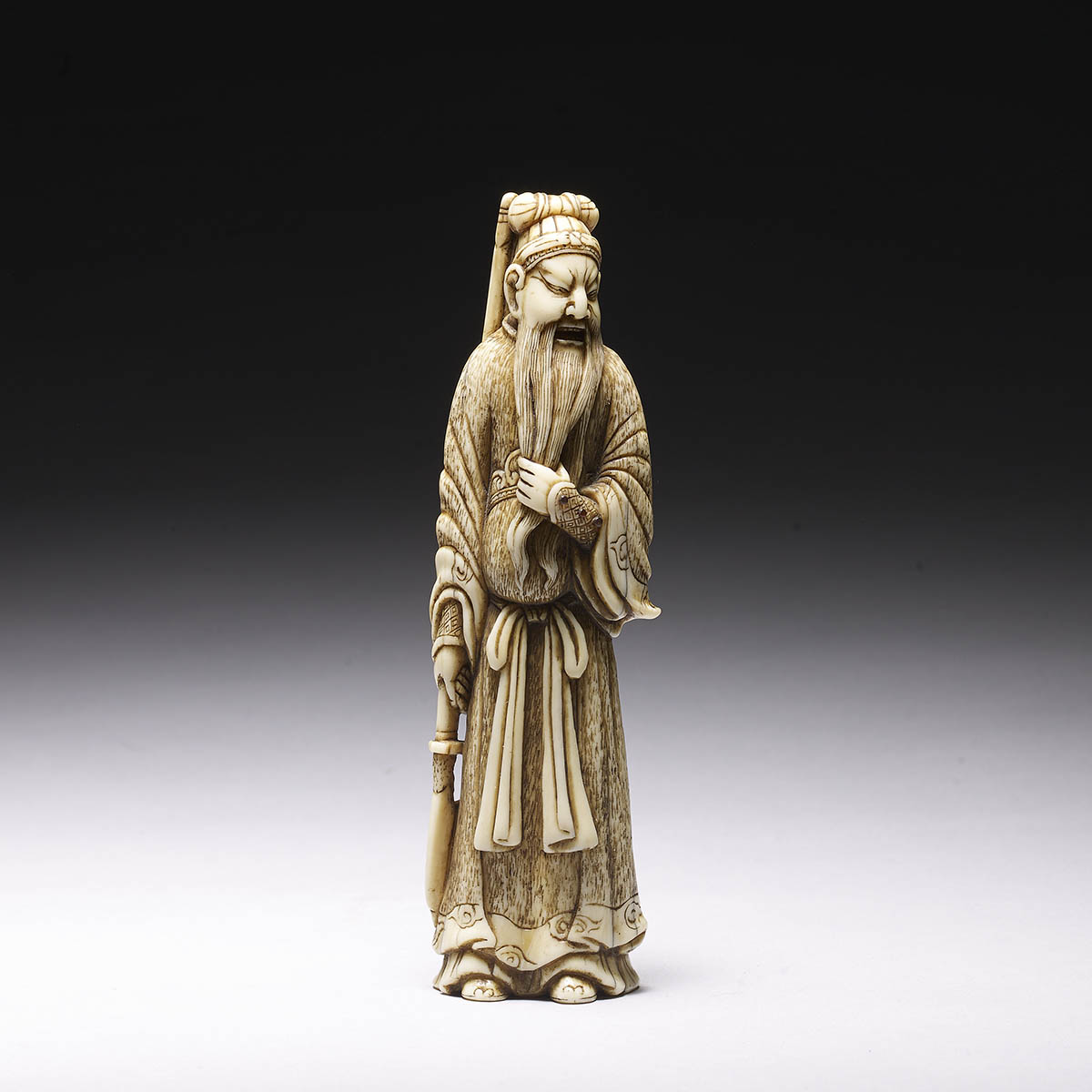 Tall ivory netsuke of Kan'u