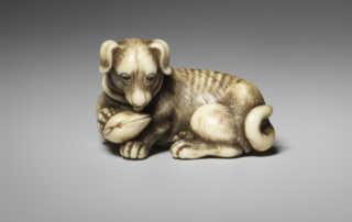 Tomotada, Ivory netsuke of a dog with shell MR2467