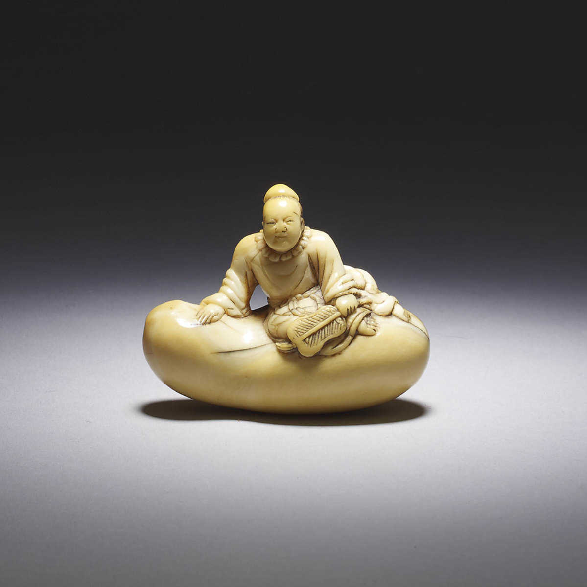 Unusual tooth netsuke of a sage on a gourd