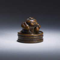 Wood netsuke of Okame in her bath