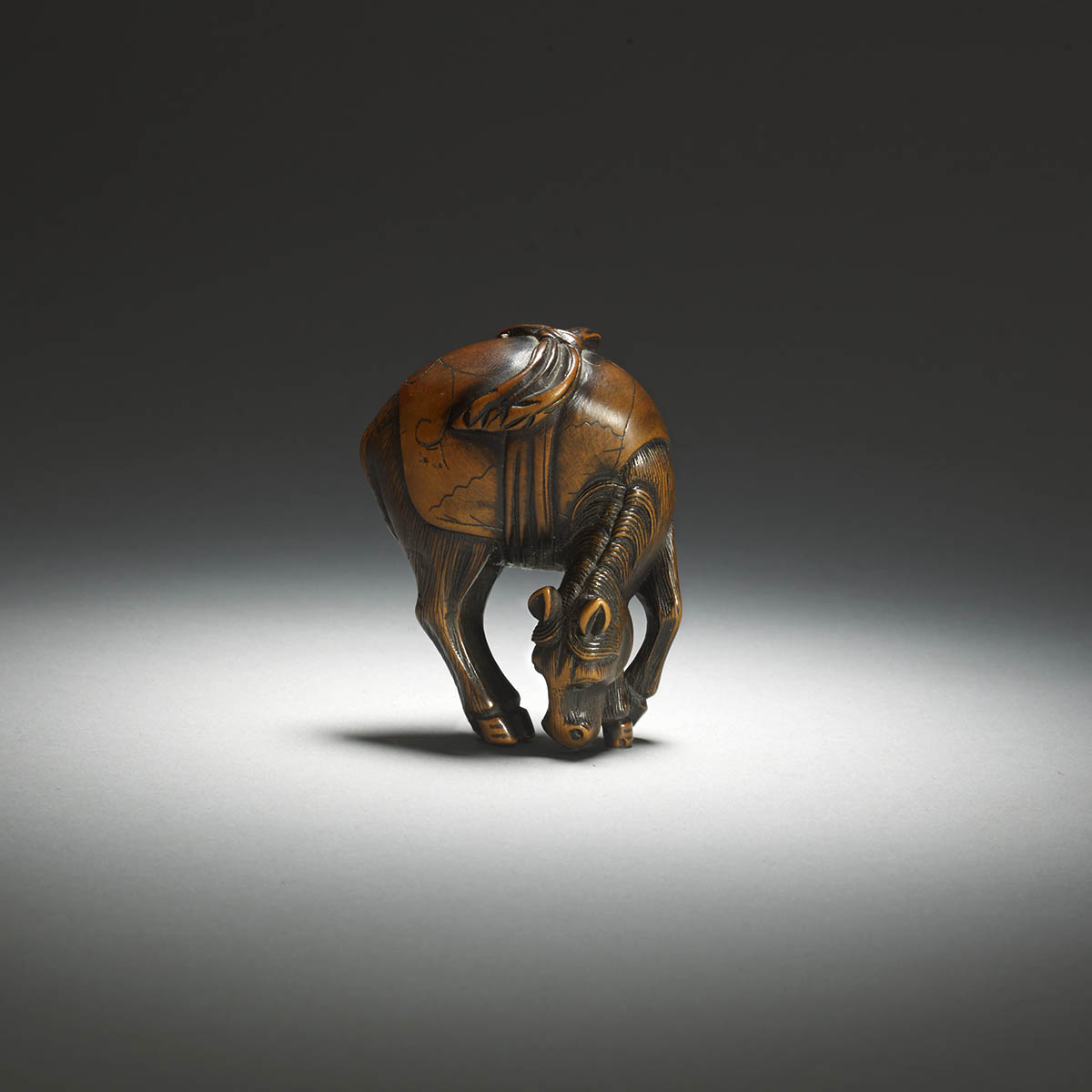 Wood netsuke of a grazing horse