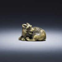 Yamaguchi Okatomo, Ivory netsuke of a recumbent wolf