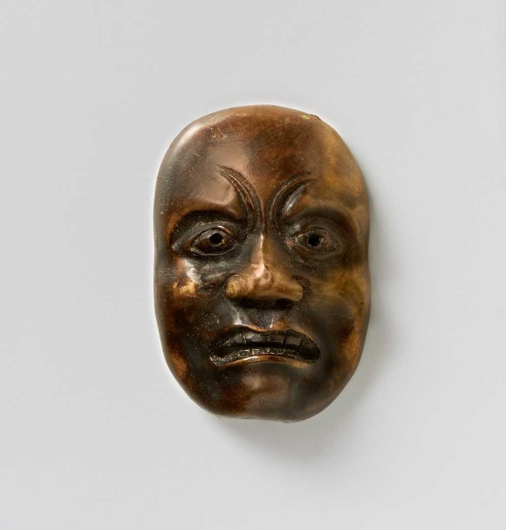 Wood mask netsuke of a Doleful man,