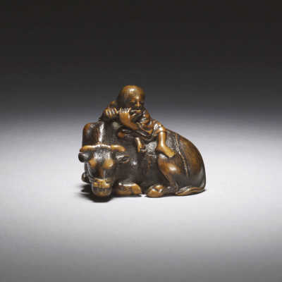 A wood netsuke of an ox and oxherd