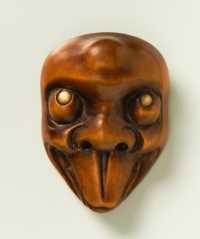 Boxwood mask netsuke of Usobuki