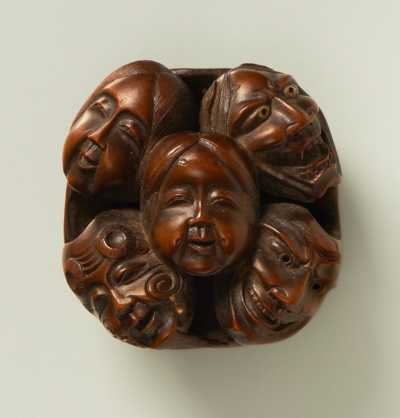 Boxwood netsuke of a cluster of masks