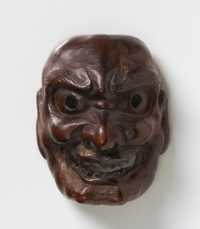 Dark wood mask netsuke of Shishiguchi