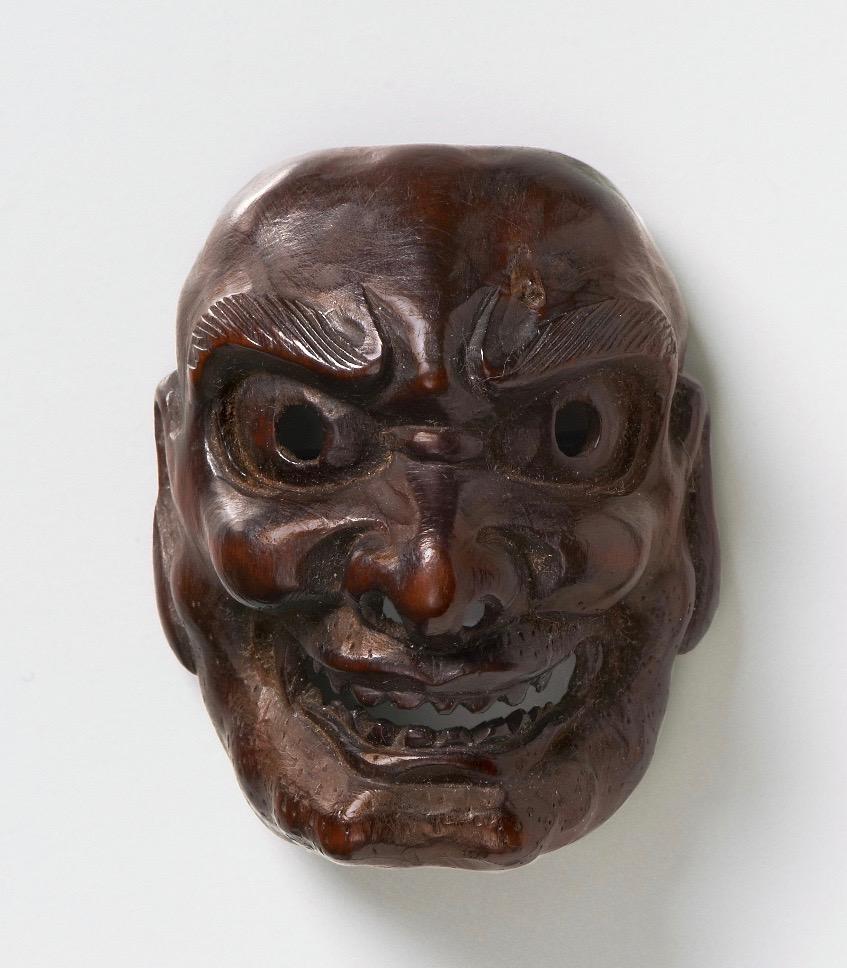 Dark wood mask netsuke of Shishiguchi
