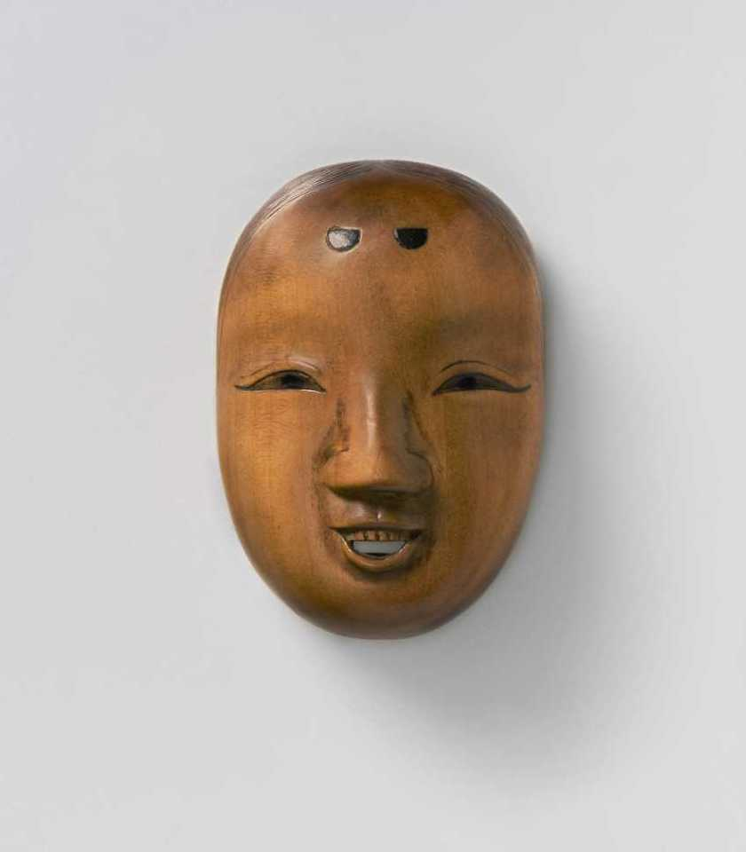Deme family, Pale boxwood mask netsuke of a smiling woman