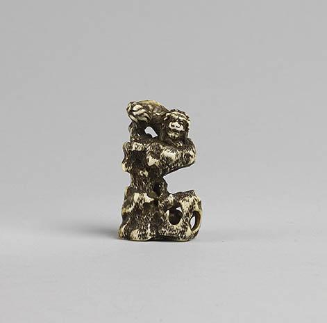 Ivory netsuke of a shishi on rock