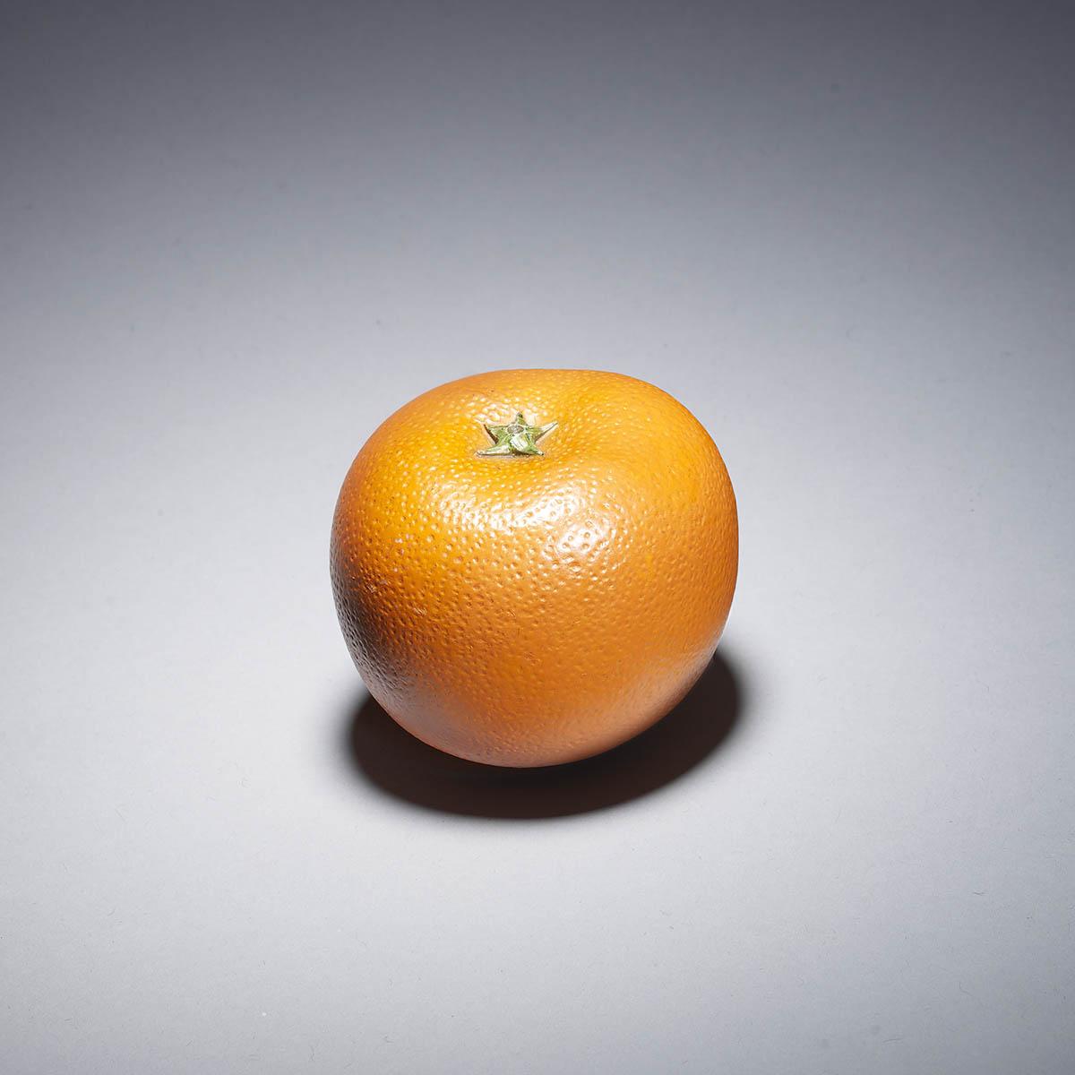 Okimono avorio di un'arancia