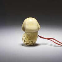 Ivory shunga netsuke of a mushroom,
