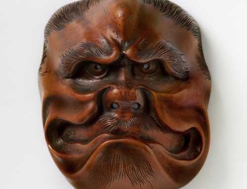 **SOLD** Large mask netsuke of a frowning Ogre