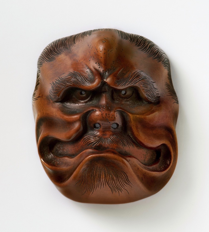 Large mask netsuke of a frowning ogre