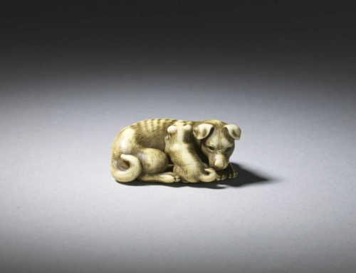 Ivory netsuke of a bitch and pup