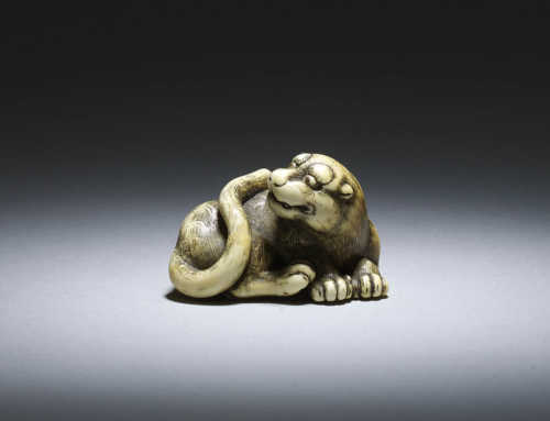 Ivory netsuke of a male tiger