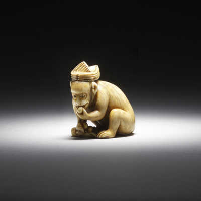 Okatomo, ivory netsuke of a performing monkey