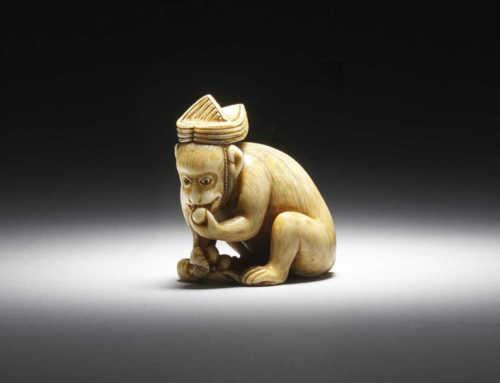 Ivory netsuke of a performing monkey