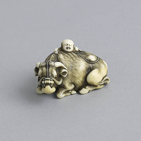 Okatomo, rare ivory netsuke of an ox and boy