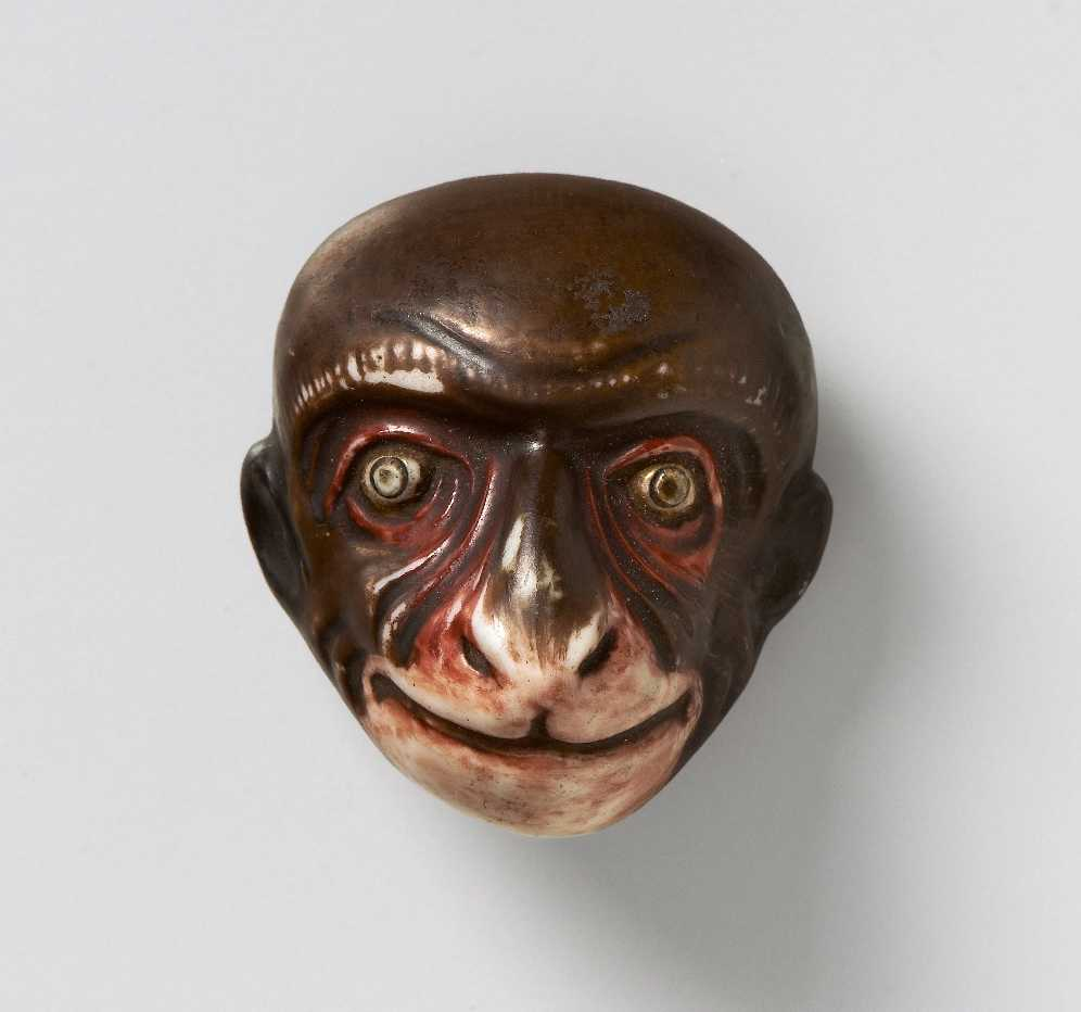 Porcelain mask netsuke of Saru