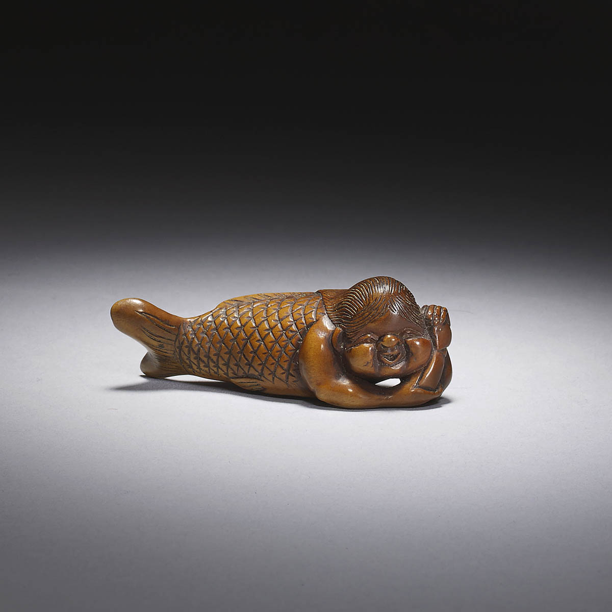 Shugetsu I, a pale boxwood netsuke of a merman