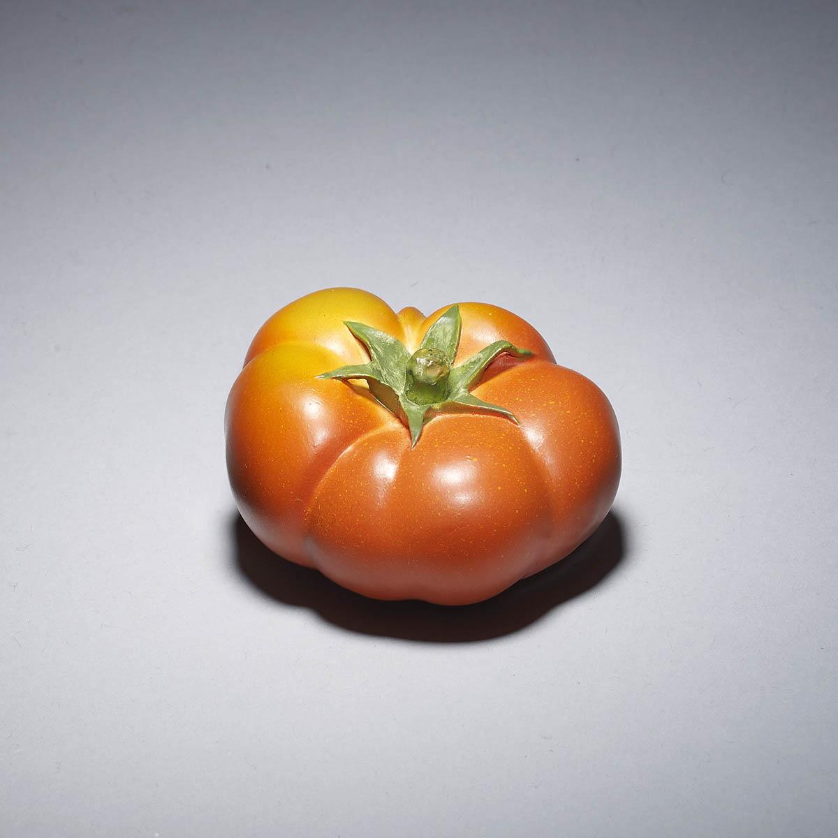 Stained ivory Okimono of a tomato