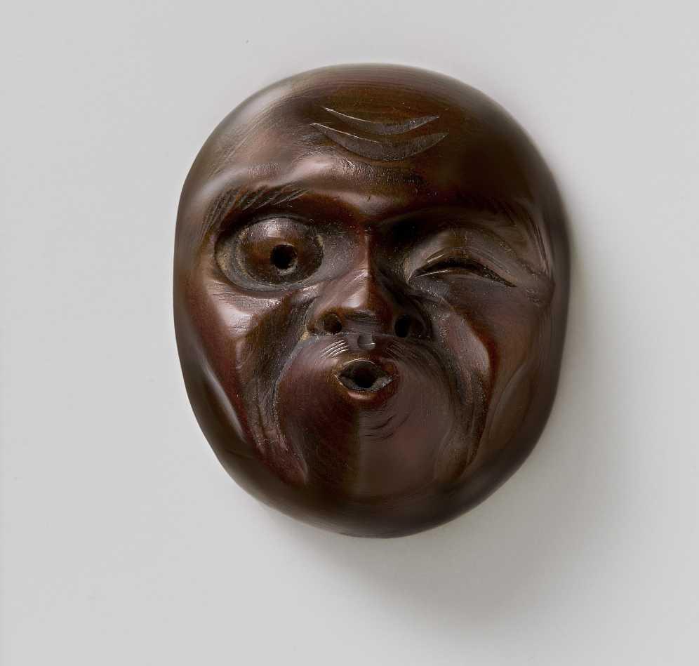 Sukenobu, wood mask netsuke of Usibuki