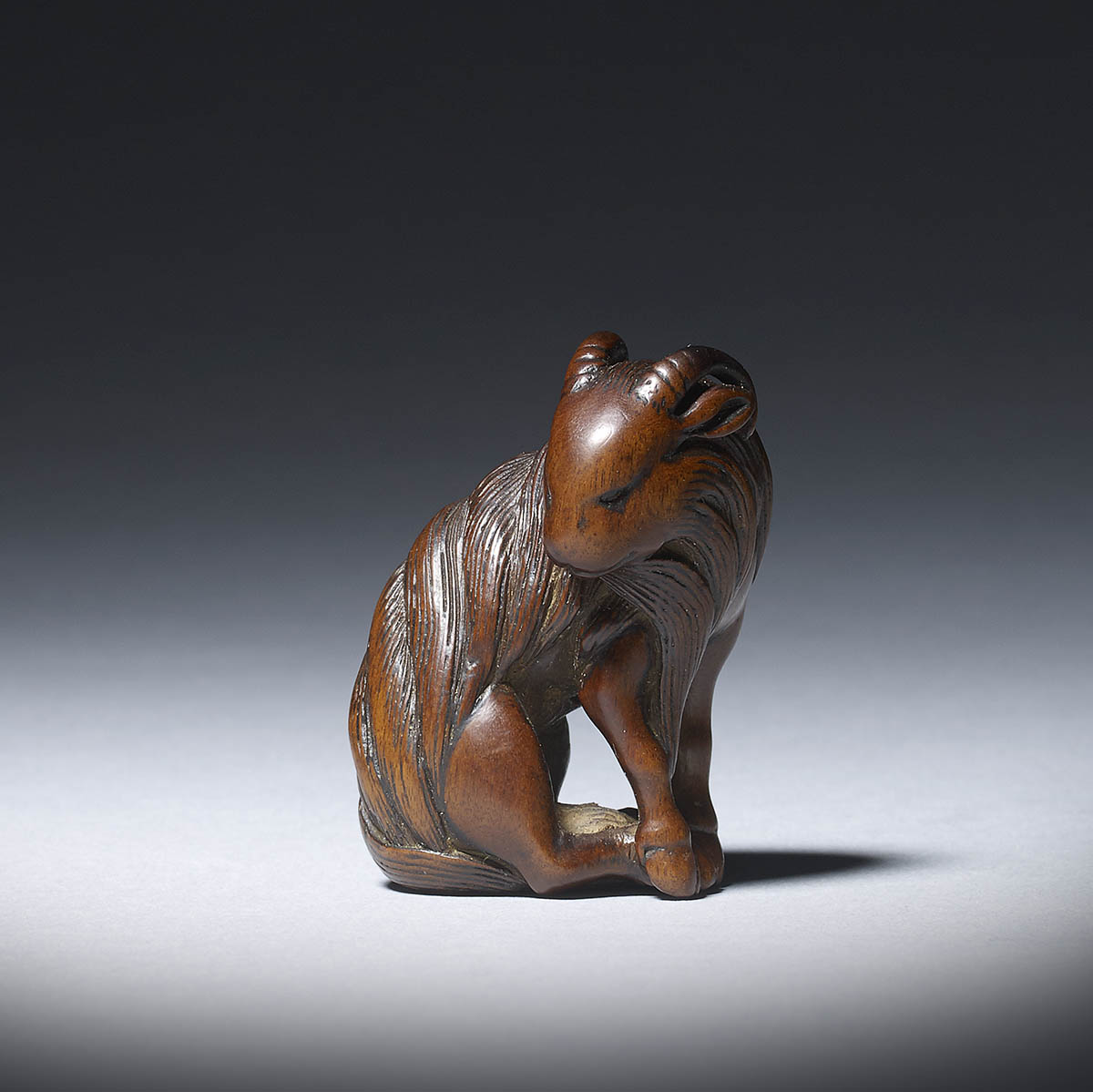 Tametaka, wood netsuke of a seated goat