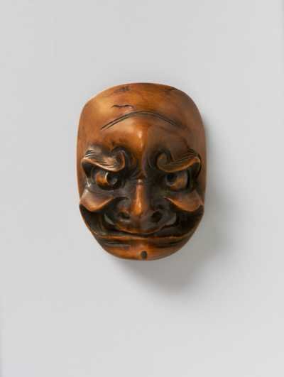 Two wood mask netsuke of a Frowning man