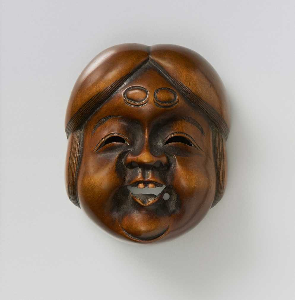 Wood mask netsuke of Okkame